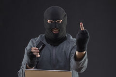 Hacker hold stolen credit card Stock Photo