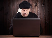 Hacker holding a credit card Stock Images