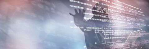 Composite image of hacker holding laptop while gesturing. Hacker holding laptop while gesturing against code Stock Image