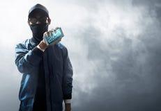 Hacker holding mobile phone Stock Photo