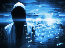 Hacker in a hood on dark blue background Stock Photo