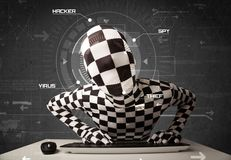 Hacker without identity in futuristic enviroment hacking persona. L information on tech background Stock Image