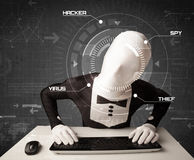 Hacker without identity in futuristic enviroment hacking persona. L information on tech background Stock Photos