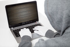 Hacker on keyboard Royalty Free Stock Photos