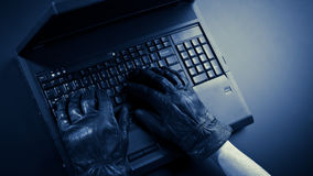 Hacker with a Laptop Royalty Free Stock Images