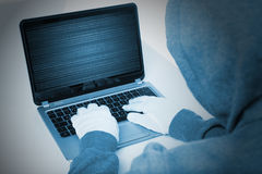 Hacker on laptop Royalty Free Stock Image