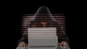 Hacker with laptop and codes Video. Anonymous Hacker with laptop and moving animated codes background stock footage