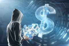Hacker with laptop and dollar sign. Cyber attack concept with hacker in grey hoody with laptop and multimedia icons on screen. digital dollar sign background royalty free stock images