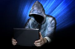 Hacker with laptop at night Royalty Free Stock Images