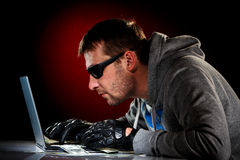 Hacker with laptop Royalty Free Stock Photos