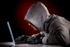 Hacker with laptop Stock Photos