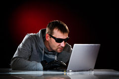 Hacker with laptop Stock Image