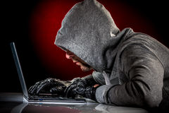 Hacker with laptop Royalty Free Stock Images