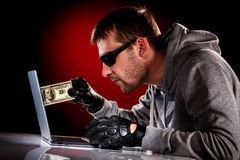 Hacker with laptop Stock Photography