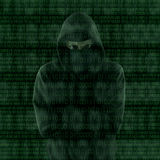 Hacker looking at binary code Royalty Free Stock Images