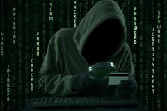 Hacker looking for credit card code Stock Images