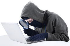 Hacker looking for information isolated Royalty Free Stock Images