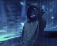 Hacker man with anonymous mask grabbing something. Over visual background stock image