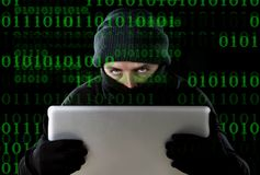 Hacker man in black using computer laptop for criminal activity hacking password and private information Stock Images
