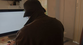 Hacker man and computer stealing information with laptop Stock Photography