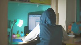 Hacker man programmer in the hood using computer for hack information and data from user account. orange color web. Hacker man programmer in hood using computer stock footage