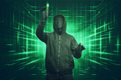 Hacker man with vendetta mask hacking binary system security cod. Hacker man with anonymous mask hacking binary system security code on the virtual screen Royalty Free Stock Images