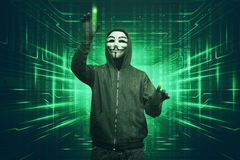 Hacker man with vendetta mask hacking binary system security cod Stock Photography