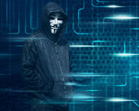 Hacker with mask on dark green digital screen. Background royalty free stock images
