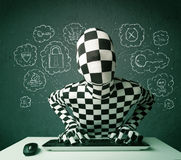 Hacker in mask morphsuit with virus and hacking thoughts Royalty Free Stock Photography