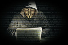 Hacker with mask Royalty Free Stock Photos