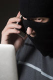 Hacker in a mask Royalty Free Stock Photo