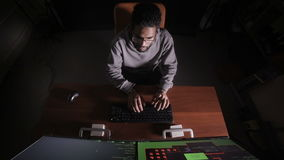 Hacker at night in a dark office hacking computer system. stock video footage