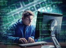 Hacker in the office. Hacker in is stealing information at home royalty free stock photos