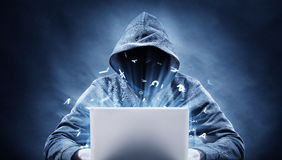 Hacker. Picture of a hacker on a computer royalty free stock photos