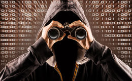 Hacker. Picture of a hacker with a spyglass stock photo
