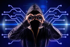 Hacker. Picture of a hacker with a spyglass stock photography