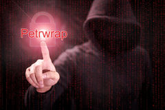 Hacker pointing Petrwrap ransomware cyber attack Royalty Free Stock Photos