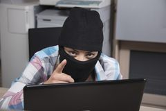 Hacker points to you, you are another attack target. Woman in the  office situation Stock Image