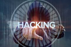 Hacker presses the button hacking . Stock Photography
