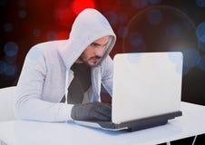Hacker que trabalha no portátil com um fundo digital foto de stock
