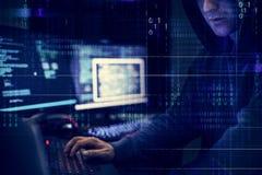 Hacker que trabalha usando o computador com códigos foto de stock royalty free