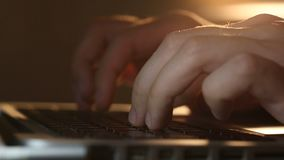 Hacker`s hands typing commands on laptop keyboard. Extremely close-up shot of hacker`s hands typing commands on laptop keyboard. Man using the laptop`s keyboard stock video