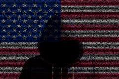 Hacker shininhg through american computer code flag. American flag made from computer code with a hooded hacker shining through cybersecurity concept Royalty Free Stock Photography
