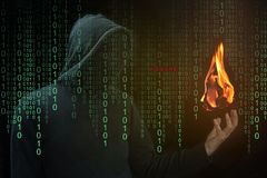 Hacker show a fireball on hand, Fireball Adware concept. Hacker show a fireball on his hand with green digital binary in foreground. Fireball Adware Infects a stock images