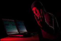 Hacker showing horns Stock Photo