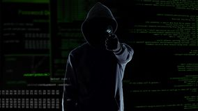 Hacker silhouette holding gun, destroying security camera, threat and crime