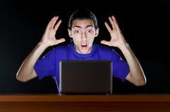 Hacker sitting in dark Stock Image