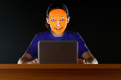 Hacker sitting in dark Royalty Free Stock Photo