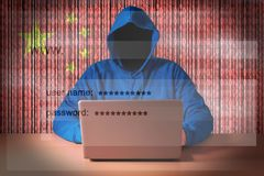 Hacker sitting in front of a laptop. On background of digital flag of China. Cyber Security concept royalty free stock images