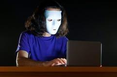 Hacker sitting in  room Stock Photos